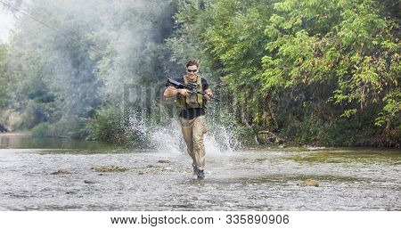 Full Military Experience - One Day Commando - Running Through The Water With Automatic Rifle Replica