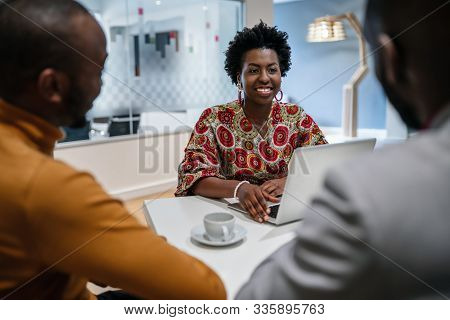 Traditional Dressed Black African Business Woman Financial Bank Adviser In Meeting With Customer. Af