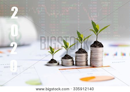2020 New Year On Growing Up Money Coin Stack For Investment.  Economic And Business Growth In 2020,