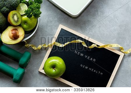 New Year For New Healthy 2020.  Fresh Vegetable Salad And Healthy Food For Sport Equipment For Women