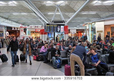 London, Uk - April 24, 2016: People Visit Duty Free Shops In London Stansted Airport, Uk. With 22.5