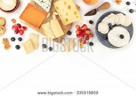 An Assortment Of Cheeses, Shot From The Top On A White Background With A Place For Text. Blue Cheese