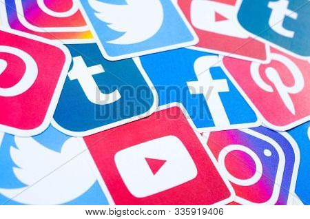 Many Social Network Printed Icons Lies In Pile. Facebook Instagram Pinterest Twitter Youtube Tumblr.