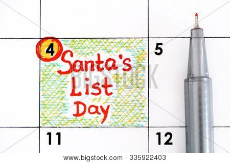 Reminder Santa's List Day In Calendar With Pen.