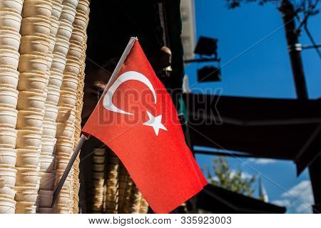 Empty Waffle Ice Cream Cones Beside Turkish Flag In The View