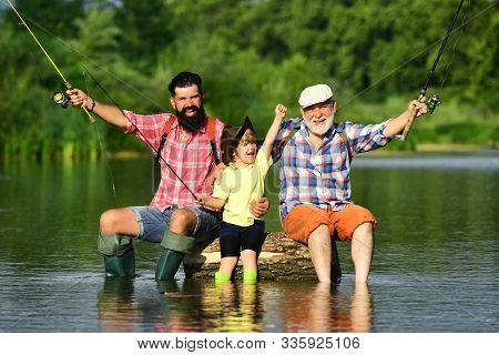 Hobby And Sport Activity. Happy People Family Have Fishing And Fun Together. Dad And Son Fishing At