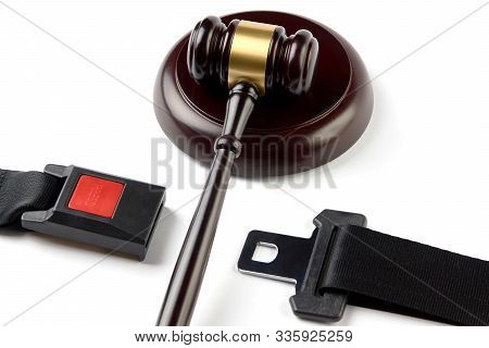 Traffic Laws Concept With Car Seat Belt And Judge's Gavel