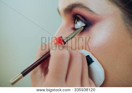 Luxury Eye Makeup Concept. Purple Smokey Eyes Makeup Close Up Photo. Professional Smokey Eyes Make U
