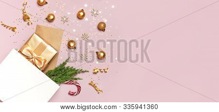 Beautiful Golden Gift White Paper Bag Confetti Stars Christmas Balls On Pink Background Top View Fla