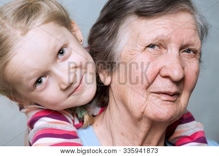 Portrait Of A Great-grandmother, Great-granddaughter, Close Up
