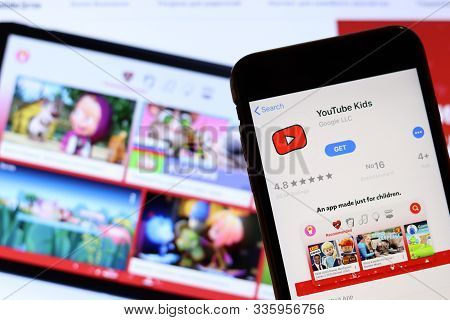 Los Angeles, California, Usa - 26 November 2019: Youtube Kids Icon On Phone Screen With Logo On Blur