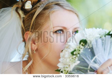 Bride Smelling Wedding Bouquet