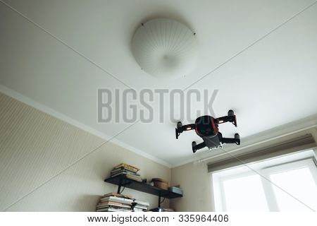 Drone Flying Indoors Inside House. Modern Trendy Technology Concept