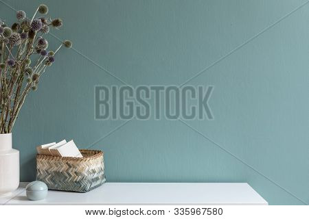 Minimalistic Interior Design Of Living Room At Nice Apartment With Stylish Shelf, Vase With Flowers,