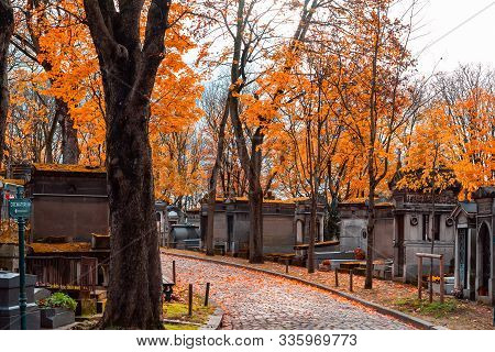 A View On Autumn Alley Of The Most Famous Cemetery Of Paris Pere Lachaise, France. Tombs Of Various