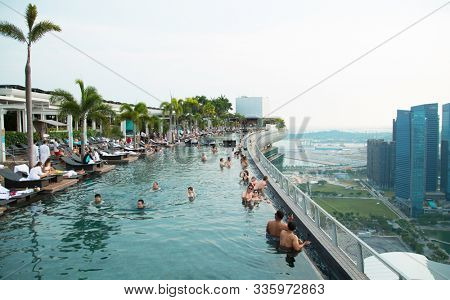 SINGAPORE - November 3th, 2019: Highest swimming pool in the world at Marina Bay Sands at 57th floors. Unique pool on top of a skyscraper in Singapore