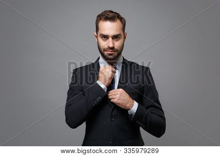 Confident Young Business Man In Classic Black Suit Shirt Tie Posing Isolated On Grey Wall Background