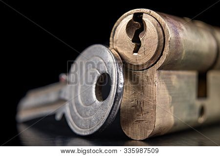 A Old Door Lock On A Dark Background. A Patent And Keys To Secure The Front Door.