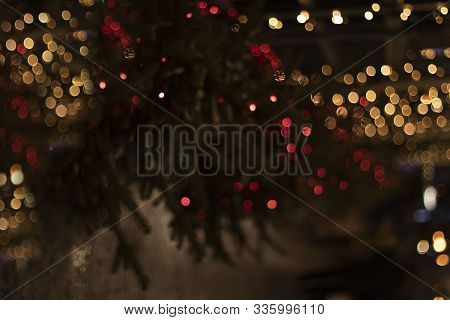 Christmas Texture Of Lights In The Dark On The Christmas Tree. Blurry Lights Of Garland At Night On
