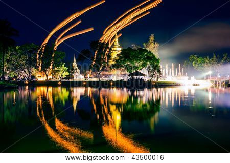 Light lampions at night above buddhist temple in Sukhothai historical park Thailand poster