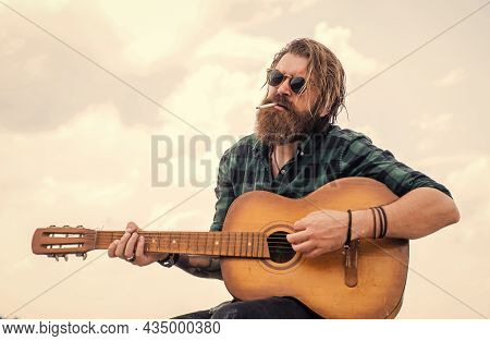 Smoking Cigarette. Casual Male Guitarist. Concept Of Music And Vocal. Man Playing The Acoustic Guita