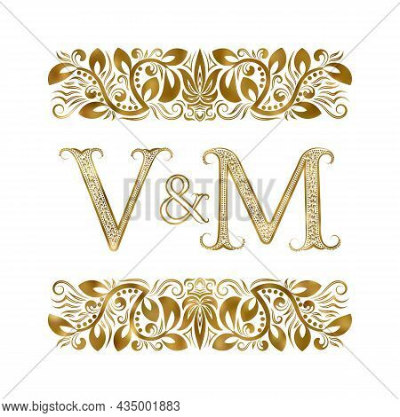 V And M Vintage Initials Logo Symbol. The Letters Are Surrounded By Ornamental Elements. Wedding Or