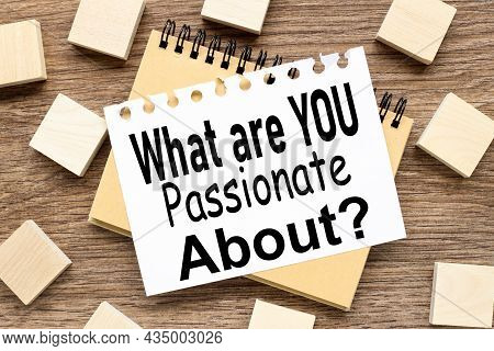What Are You Passionate About. Top View Of Office Wood Table. White Sheet Of Paper On A Notebook. Wi