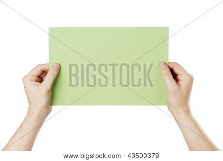Man holding a blank light green paper against white background.