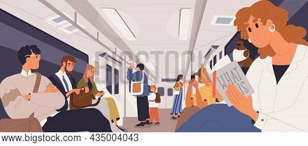People Inside Subway Train, Stand And Sit With Books And Mobile Phones. Passengers Commuting In City