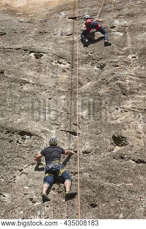 Climbers On A Granite Wall. Extreme Sport. Outdoor Mountain Activity