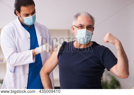 Old man visiting young doctor in covid-19 vaccination concept