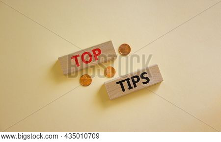 Top Tips Symbol. Concept Words 'top Tips' On Wooden Blocks On A Beautiful White Background, Metallic