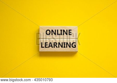 Online Learning Symbol. Concept Words 'online Learning' On Wooden Blocks On A Beautiful Yellow Backg