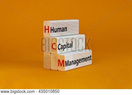 Hcm, Human Capital Management Symbol. Concept Words Hcm, Human Capital Management On Wooden Blocks O