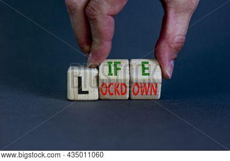 Life With Lockdown Symbol. Doctor Turns Wooden Cubes And Changes Words 'lockdown' To'life'. Beautifu