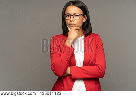 Puzzled Thoughtful Businesswoman Pondering Doubtful Of Business Development Strategy Or Partnership