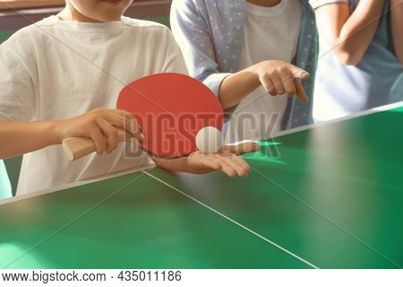 Little Boy With Friends Playing Ping Pong Indoors, Closeup
