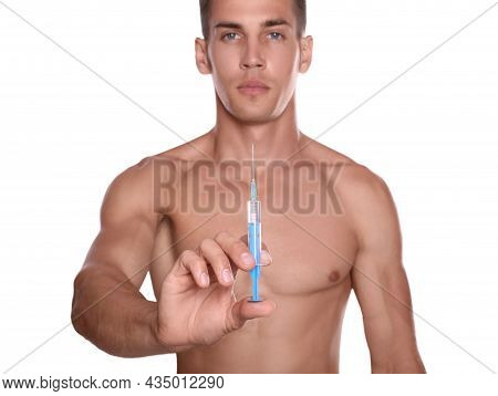 Athletic Man With Syringe Against White Background, Focus On Hand. Doping Concept