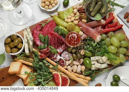 Set Of Different Delicious Appetizers Served On White Marble Table, Flat Lay