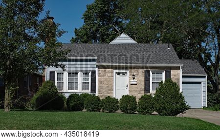 Small Single Story, Stone Front House with Shrubs