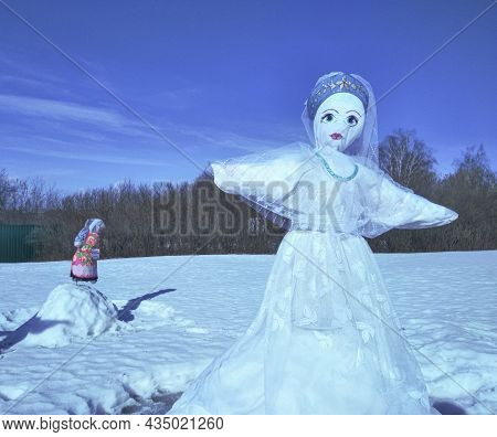 The Snowman Dummy. An Effigy Of Shrovetide For Burning. White Doll With Crown Dressed For The Burnin