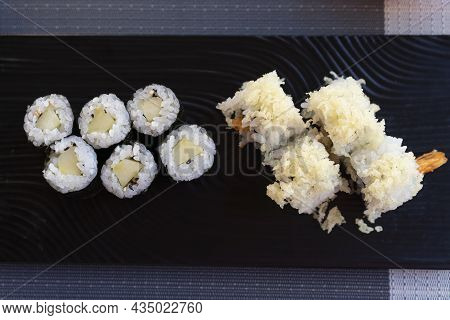 Traditional Japanese Rolls Sushi With Cucumbers And Rolls Sushi With Shrimps Fried On Black Plate, V