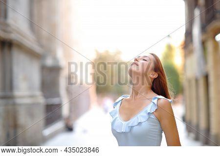 Woman Relaxing Breathing Fresh Air In The Street