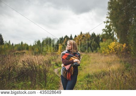 A Beautiful Woman, Blonde Meditates And Relaxes In The Autumn Forest. The Concept Of Slow Life And U