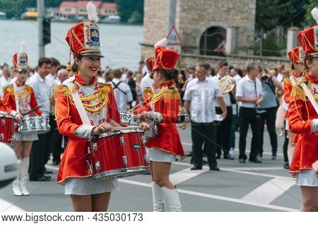 Ternopil, Ukraine July 2, 2021: Young Girls Drummer In Red Vintage Uniform At The Parade. Street Per