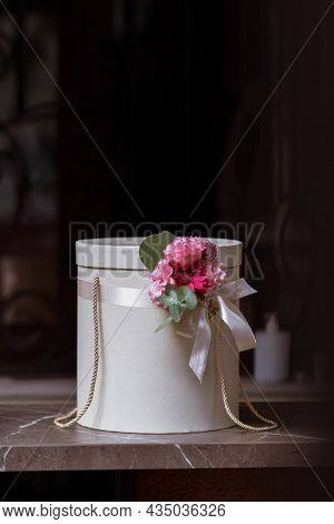 Floral Hat Boxes On A Dark Background