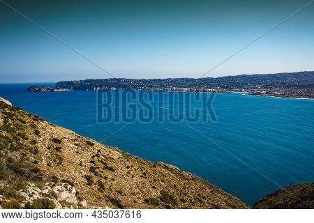 Mediterranean Seascape On Costa Blanca. Cape San Antonio On The North Coast Of Alicante Province In