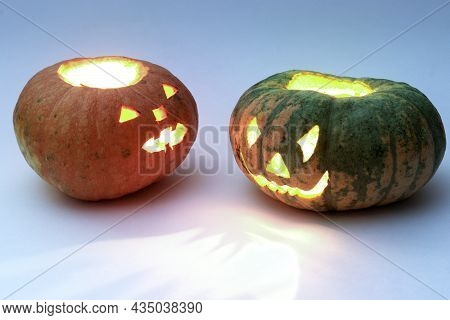 Different Pumpkins For Halloween, Looking At Each Other. Green And Orange Lobed Pumpkins With Crudel