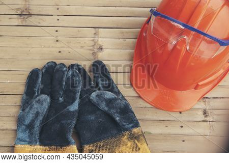 Top View Of Safety Helmet (hard Hat) And Glove For Engineer, Safety Officer Or Architect, Place On O
