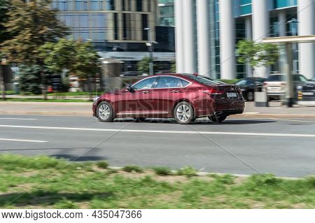 Red Color Genesis G80 First Generation In Fast Motion On The Street. Moscow, Russia - August 2021